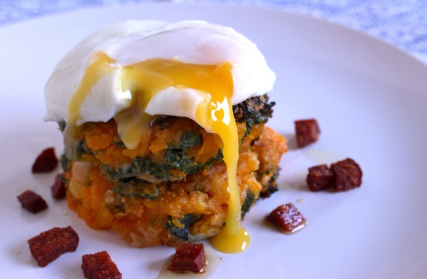 Butternut squash and kale fritters, with chorizo and poached egg